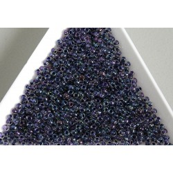 Toho R11-181, Inside-Color Rainbow Crystal/Tanzanite Lined, 10g