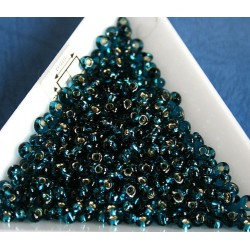 M03-27BD margele Toho magatama 3mm, silver lined teal, 10g