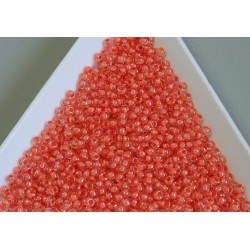 Toho R11-964, Inside-Color Crystal/Dark Coral Lined, 10g